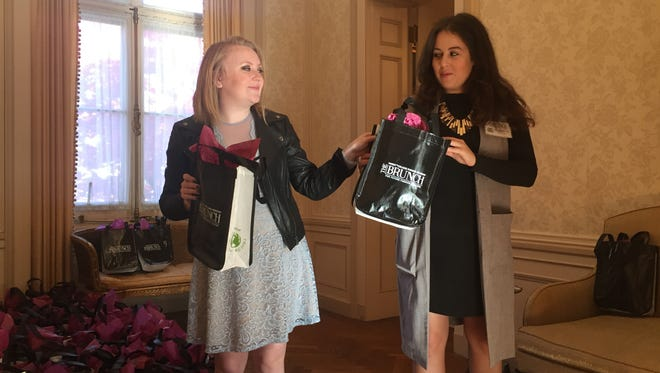 Marist College students Alyssa Roche and Joanna Puccio arrange gift bags Sunday prior to The Brunch, an event held by the Marist College Fashion Program.