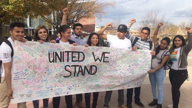 Colorado State University students hold a banner inscribed with messages of support for students who are undocumented immigrants. A rally in solidarity was held for undocumented students at the CSU plaza on Monday.