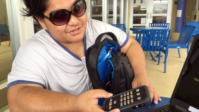 Guam Community College student Finia Kachita, 30, shows off her new Victor Reader, which has built in Wi-Fi, allowing her to download audio books for her studies. Kachita has been blind since she was 2 years old and works with the local blind advocacy group New Vision Guam.