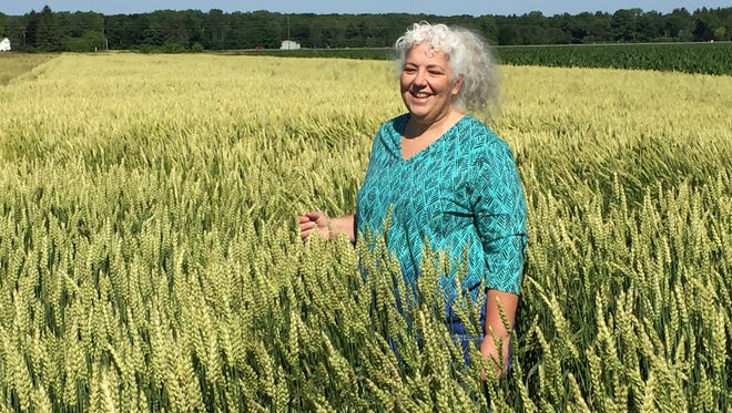 Deirdre Ortiz, a fellow of global research, who is known as Dr. Wheat, at Kellogg in Battle Creek. She is in a field of waxy wheat.
