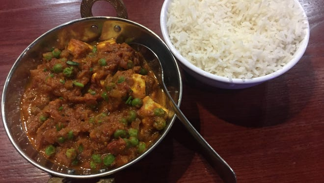 Mutter Paneer features Indian cheese and peas in a tomato-based sauce.