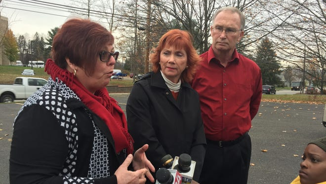 Democratic legislators, from left, Mary Kaminsky, Kim Myers and Mark Whalen speak against the legislature's proposed budget changes at a news conference Tuesday.