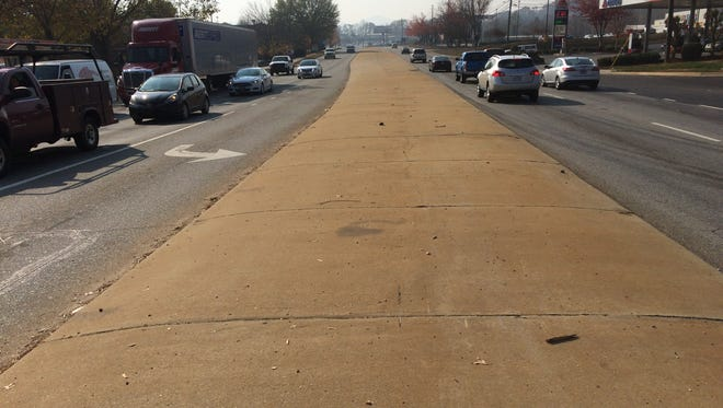 The concrete apron on Brevard Road will not be removed any time soon.