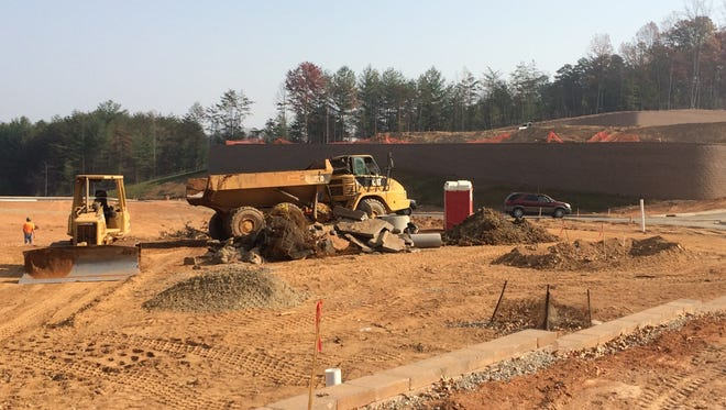 A Greensboro company is building luxury apartments in 13 buildings on this site off Sardis Road in Enka.
