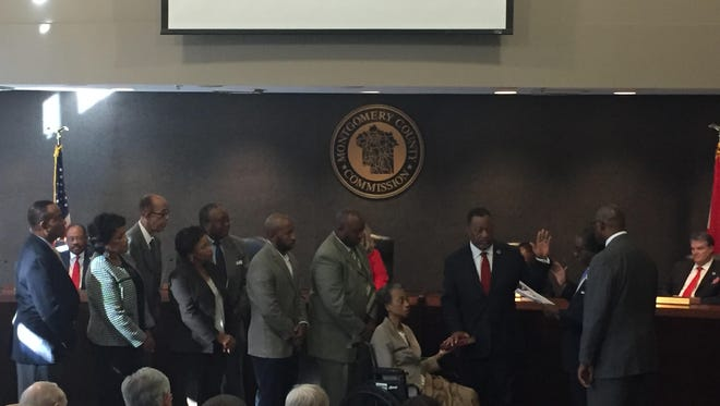 Elton Dean's family stands behind him as Circuit Judge Charles Prices swears him as District 2 County Commissioner.