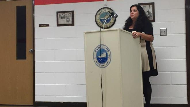 Linda Davis Kirksey, of Davis Kirksey Associates, Inc., addresses Marine City commissioners during their regular meeting on Thursday, Nov. 17, 2016.