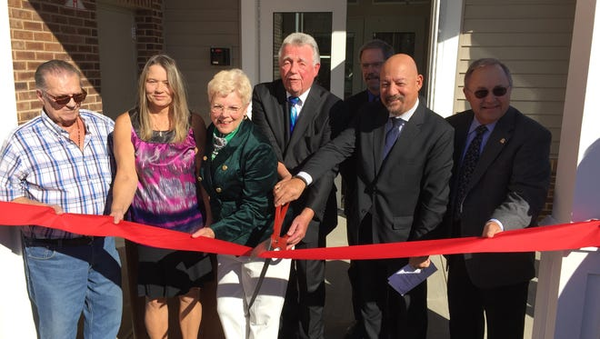 The ribbon-cutting at Davenport Village, an affordable housing community in Morris Plains, included John & Theresa Lardieri, residents;           Suzanne McCluskey, Council President; Mayor Frank Druetzler; Leon Hall, Borough Engineer; Louis Riccio, E.D. Madison Affordable Housing Corp.; George Coogan, Affordable Housing Committee Member.