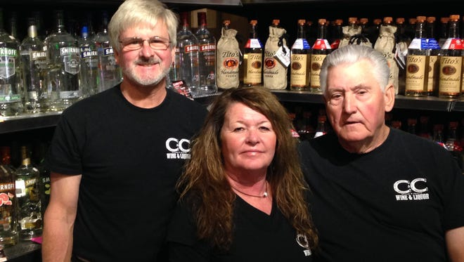 From left: Greg, Betty and Bud Heath, owners of C&C Wine & Liquor, 2644 N. Highland Ave.