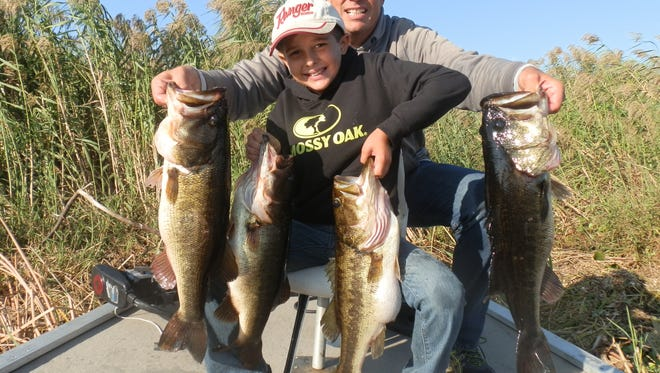 Capt. Nate Shellen and son Ethan, 8, of Vero Beach enjoyed some great bass fishing on wild shiners Thursday along with grandpa Capt. Mike Shellen. They caught great numbers of fish including Ethan's largest to date, an 8-pounder.