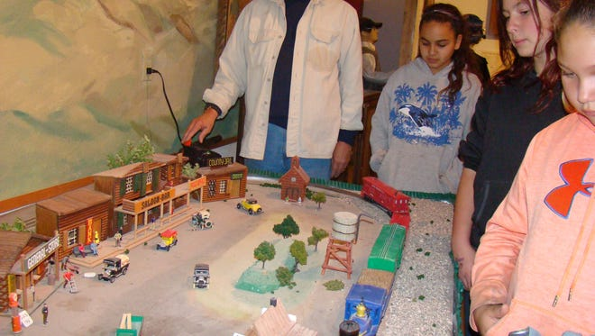 Rick Geary shows Carrizozo 5th and 6th grade students a model train set. The exhibit was designed by Carrizozo Heritage Museum to look like a typical scene of a busy early day railroad town.