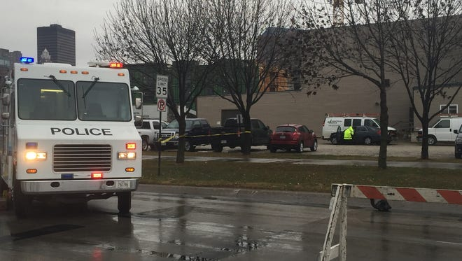 The car in the background of this photo, where the police officer with yellow clothing is investigating, crashed into two other vehicles before coming to a rest in that parking lot at Southwest Second Avenue and West Martin Luther King Jr. Parkway on Nov. 22, 2016.