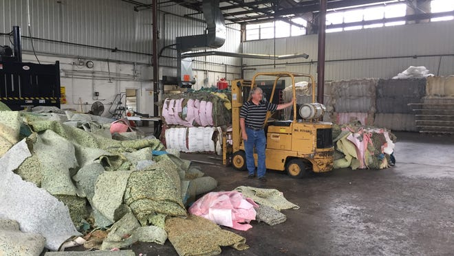 BedHead Mattress Recycling co-owner J.L. Phillips takes a break at the company's Billings warehouse in a June 2016 photo.