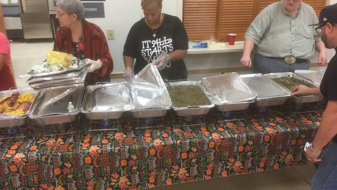 Dozens of volunteers showed up in Titusville on Thursday to serve an estimated 500 people for Harvest of Hope's first community Thanksgiving dinner.