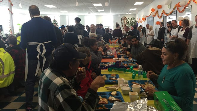 A Thanksgiving feast is provided to those in need at the St. Vincent's Dining Room on Thursday.