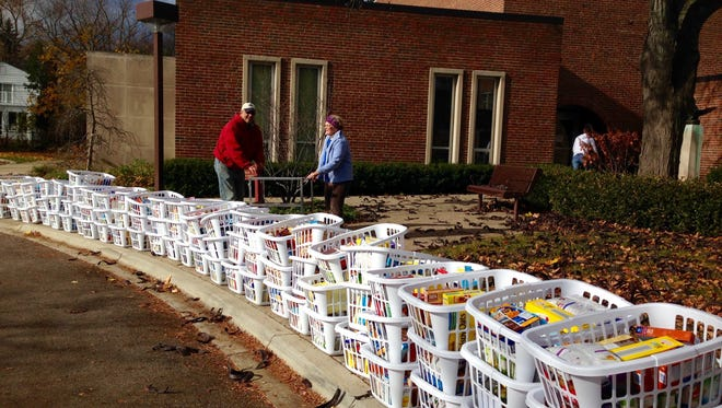 The donated food stretches along a long line outside First Presbyterian Church of Birmingham.