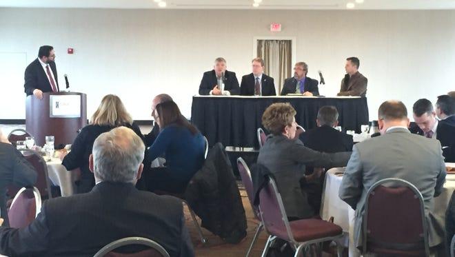 Iowa Chamber Alliance Executive Director John Stineman leads a panel with state legislators Thursday.
