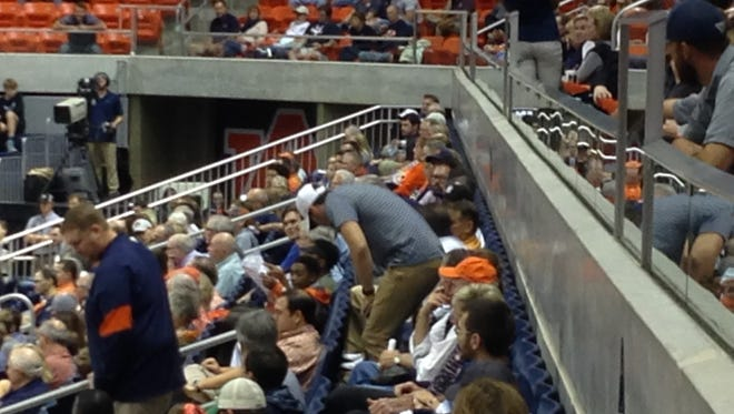 Former Baylor quarterback Jarrett Stidham (in white hat) shows up at Auburn Arena for the basketball game Tuesday night.