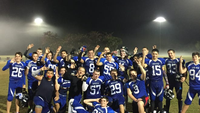 The Donahue Catholic Academy football team celebrates its 47-6 state semifinal win over Jacksonville-Oak Plank Christian on Thursday, Dec. 1, 2016. The Shamrocks will head to the title game for the third time in four years.