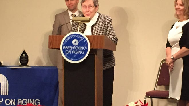 Ann Bishop receives her award for advocate of the year at the Area Agency on Aging annual meeting on Thursday.
