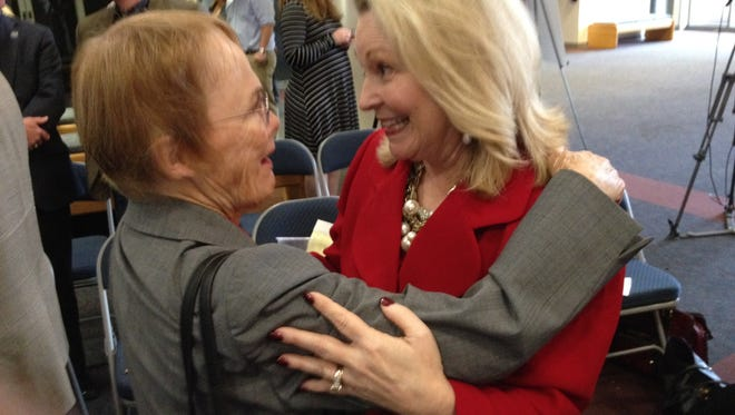 Mary Pankowski, left, whose family provided funding for the Honors Lounge, and Karen Moore, campaign chairman embrace following $13 million total announcement Thursday.