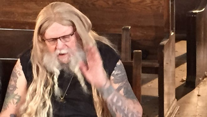 """David Allan Coe sings """"Take This Job and Shove It"""" during a video shoot Friday at the Ohio State Reformatory."""