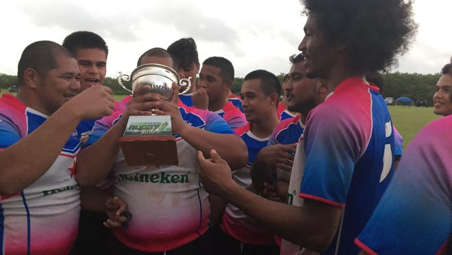 The Guam Rugby Club celebrate winning the Heineken Rugby 15s championship.