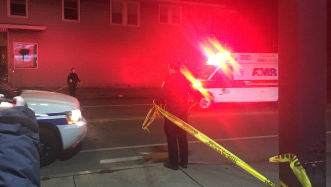 An ambulance leaving the scene of a Rochester shooting/stabbing in Charlotte Saturday night.