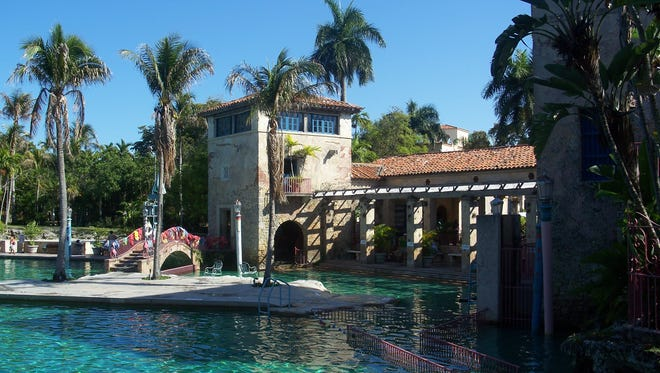 The Venetian Pool is an example of the Mediterranean style architecture and meticulous landscaping that define the planned community of Coral Gables.
