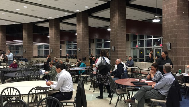 Community members gathered at East Lansing High School Monday night for a open forum to discuss proposals to build new elementary schools.