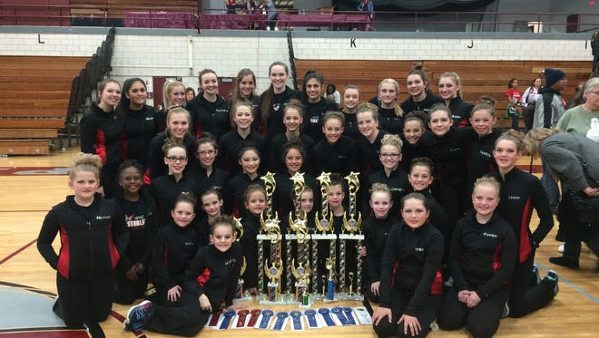 The Starlites competitive dance team poses after a recent competition.