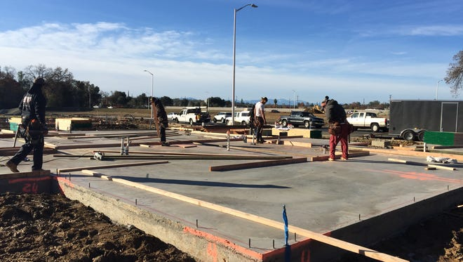 Workers with Lahr Construction frame a house in River Pointe off Waverly Avenue in Redding.
