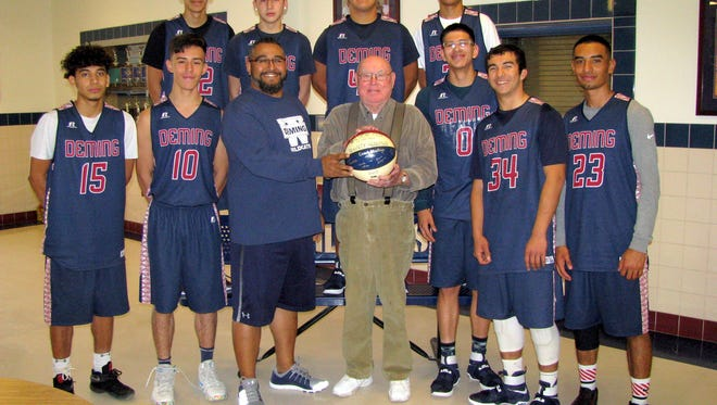 """Fletcher """"Shanty"""" Bowman showed his 2005 Fan of the Year Basketball to coaches and Wildcat players at Deming High School on Wednesday, Nov. 30, 2016. He wished the Cats well on their season and sayid he will make reservations for the state tournament in Albuquerque."""