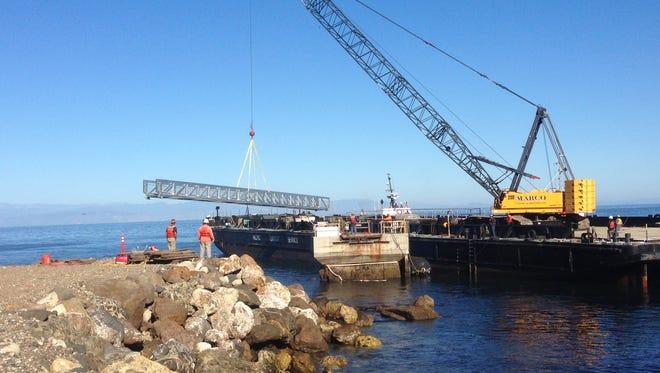 Crews used a crane to drop a temporary pier in place on Santa Cruz Island.