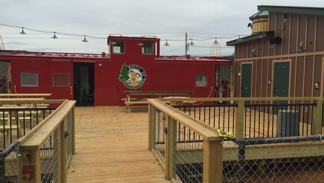 Whistle Hop Brewing has a large patio and a separate outbuilding to go with its caboose.