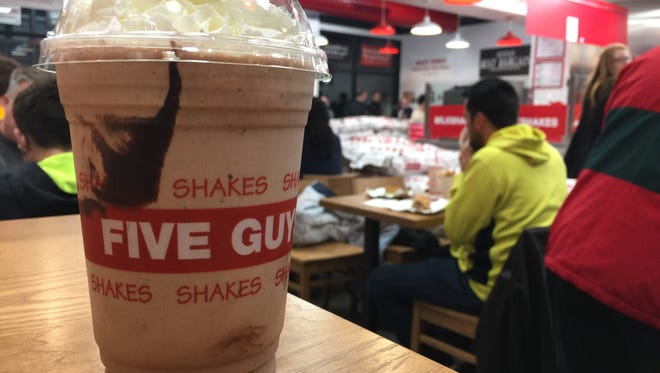 Coke products are served to drink at Five Guys, or customers can choose from one of 11 flavors for a milkshake (with or without whip cream) for $4.49.