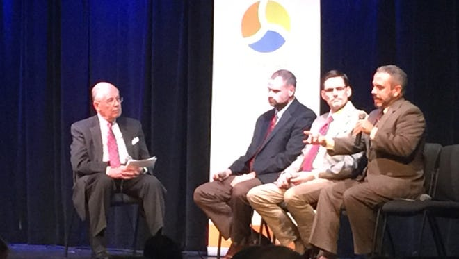 Tom Ballard (from left) leads a discussion on advanced energy with Ben Jordan of Centrus Energy, Jim Plourde of Schneider Electric, and Alan Franc of Techmer ES, on Tuesday at Cafe 4.