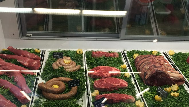 Steaks and sausages at Becher Meat & Provisions at the Urban Food Market.