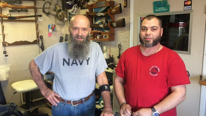 David Stevens, left, and his stepson, David Gibbs, say it's time to close Daggitt's Pawn Shop on Haywood Road in West Asheville after a 25-year run.