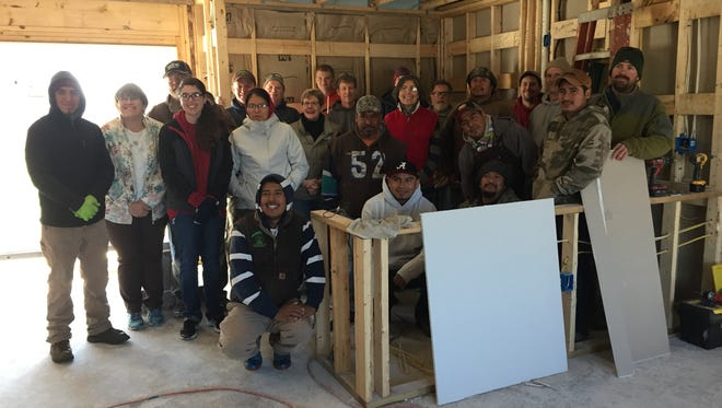 Volunteers from Habitat for Humanity and Hollabaugh Bros., Inc. pose for a photo in the house in Biglerville being built for two Hollabaugh Bros employees.