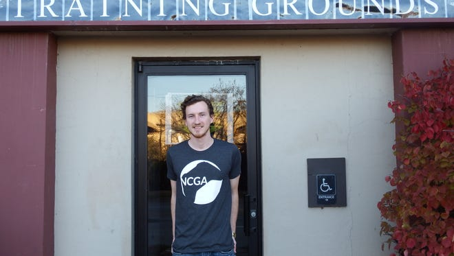 Training Grounds video game center founder Connor Alne in front of his business in downtown Iowa City on Nov. 9 2016.