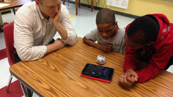 Carper, Isaiah Jones and Jordan Davis program their Sphero to make shapes and change colors.