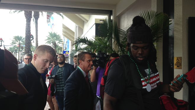 UL head football coach Mark Hudspeth and members of the Ragin' Cajuns football team arrive Tuesday in New Orleans ahead of the New Orleans Bowl to be played Saturday.