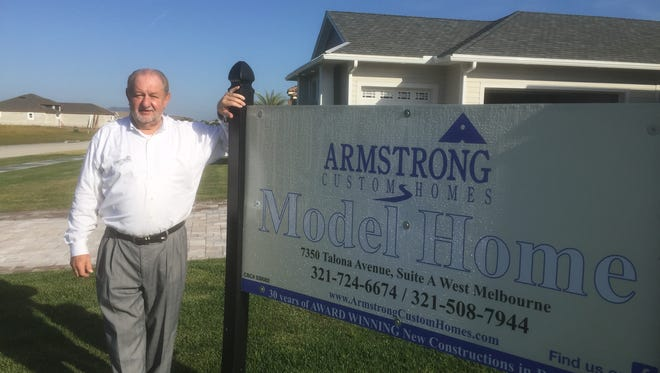"""Dave Armstrong started Armstrong Custom Homes 30 years ago. The Melbourne Regional Chamber of East Central Florida recently held a ribbon-cutting at one of his new homes, a Craftsman style house, at 3557 Province Dr., Melbourne.  The Home Builders and Contractors Association of Brevard have twice named Armstrong """"Builder of the Year"""" and is the recipient of the association's Eagle Award."""