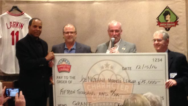 (Left to right) Hall of Famer Barry Larkin, Green Diamond Gallery's Bob Crotty and Joe Nuxhall Miracle League Fields' Kim Nuxhall and Larry Tischler during the Character and Courage Foundation grant presentation Thursday night.