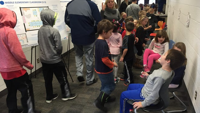 First grade students from Crull Elementary scope out possible new furniture for their classroom on Friday