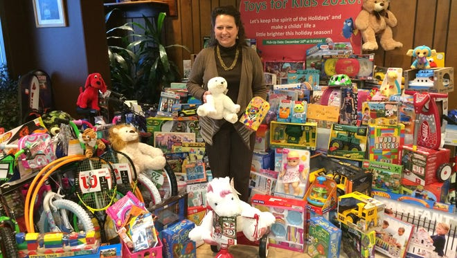 Julie Koch, Bay Shipbuilding contracts manager, has been running the company's toy drive for more than 25 years.