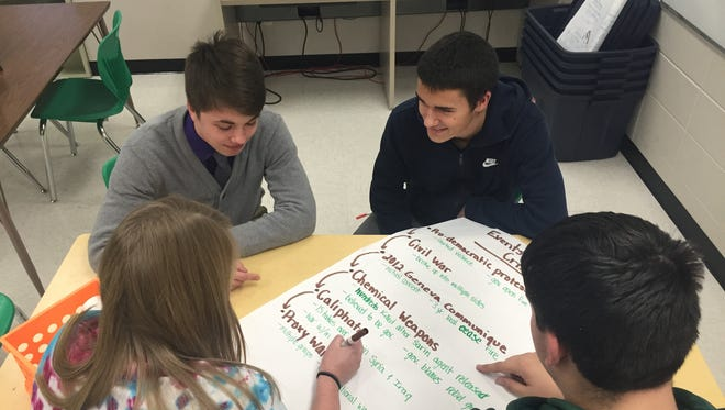 Emillie Rathsack, from left, Wil Schmidt, Daniel Colombana and Tyler Koelbl collaborate to learn about the Syrian conflict.