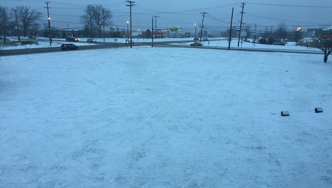 Snow covered the ground early Saturday morning in Neptune.