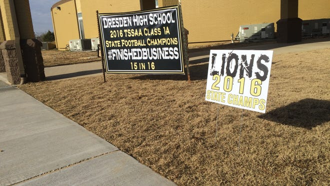 Signs in front of the Dresden High School entrance announce the football championship for any visitors who might be unaware.