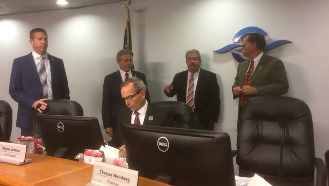 From let, Micha Loyd (CPA commissioner) John Murray (president and CEO of Port Canaveral) Wayne Justice (CPA commissioner) Harold Bistline (port attorney) and Tom Weinberg (chairman of the CPA) prior to Tuesday's Canaveral Port Authority meeting where the issue of cargo rail was discussed.